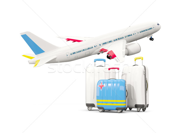 Luggage with flag of aruba. Three bags with airplane Stock photo © MikhailMishchenko