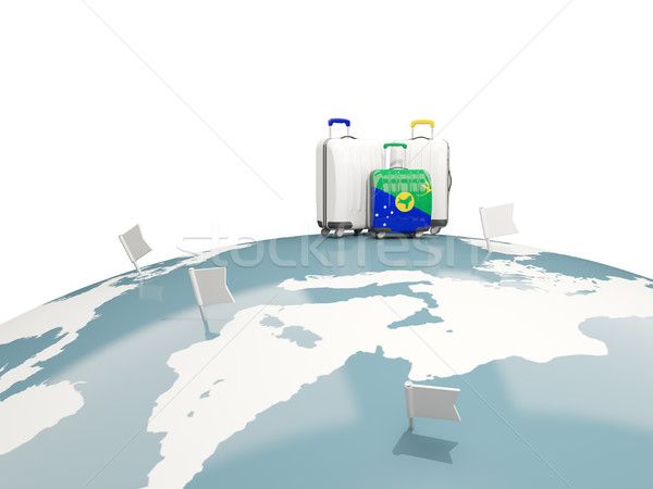 Luggage with flag of christmas island. Three bags on top of glob Stock photo © MikhailMishchenko