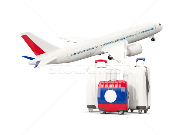 Luggage with flag of laos. Three bags with airplane Stock photo © MikhailMishchenko
