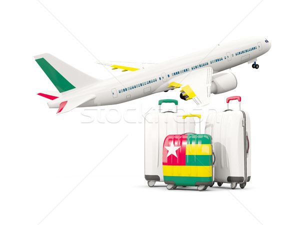 Luggage with flag of togo. Three bags with airplane Stock photo © MikhailMishchenko