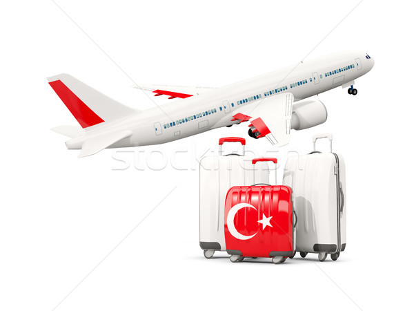 Luggage with flag of turkey. Three bags with airplane Stock photo © MikhailMishchenko