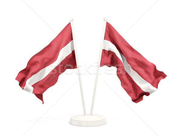 Twee vlaggen Letland geïsoleerd witte Stockfoto © MikhailMishchenko