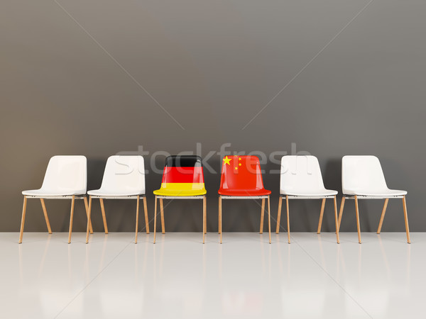 Chairs with flag of Germany and china in a row Stock photo © MikhailMishchenko