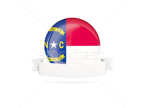 Flag of north carolina with banner, US state round icon Stock photo © MikhailMishchenko
