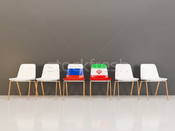 Chairs with flag of Russia and iran Stock photo © MikhailMishchenko