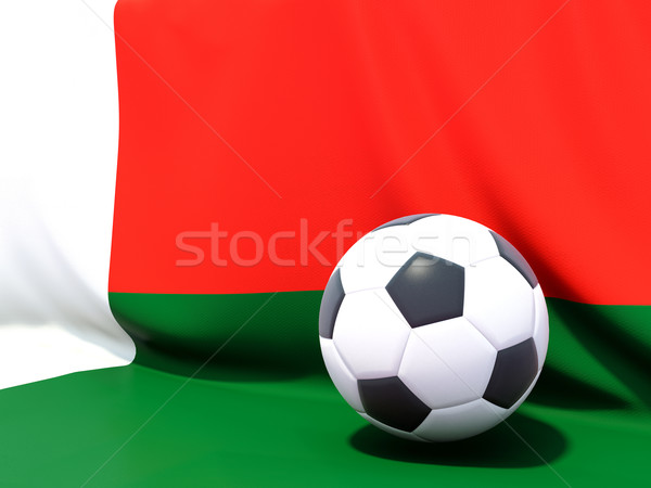 Flag of madagascar with football in front of it Stock photo © MikhailMishchenko