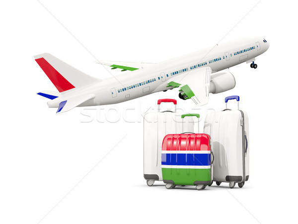 Luggage with flag of gambia. Three bags with airplane Stock photo © MikhailMishchenko