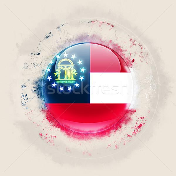 georgia state flag on a round grunge icon. United states local f Stock photo © MikhailMishchenko
