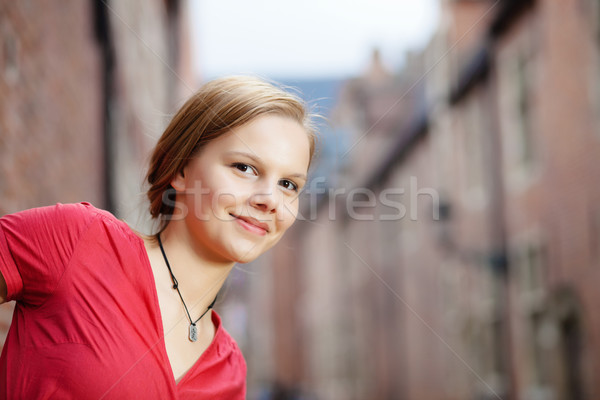 Pretty blond woman in red dress Stock photo © MikLav