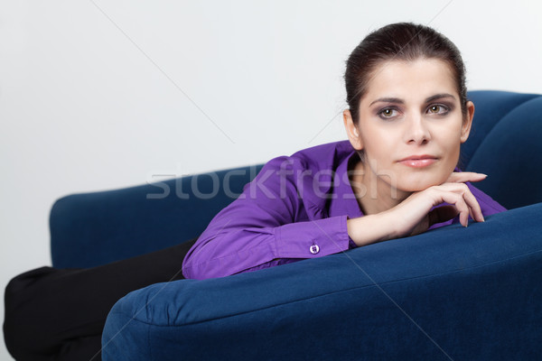 Young woman on a couch Stock photo © MikLav