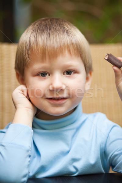 少年 チョコレート キャンディ かわいい 笑みを浮かべて ストックフォト © MikLav