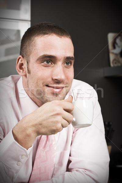 カップ コーヒー 若い男 座って キッチン ビジネスマン ストックフォト © MikLav