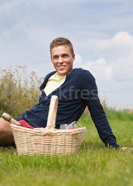 Piknik fiatal szőke férfi ül fű Stock fotó © MikLav