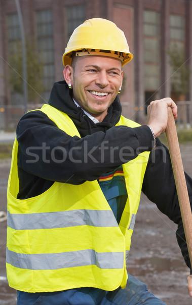 Jó hangulat nevet építőmunkás citromsárga védősisak férfi Stock fotó © MikLav