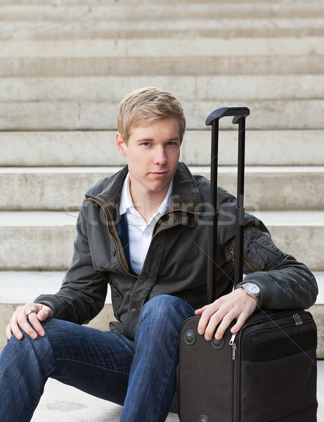Young blond man with suitcase Stock photo © MikLav