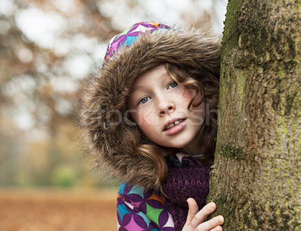 Teenager girl poking around a tree Stock photo © MikLav