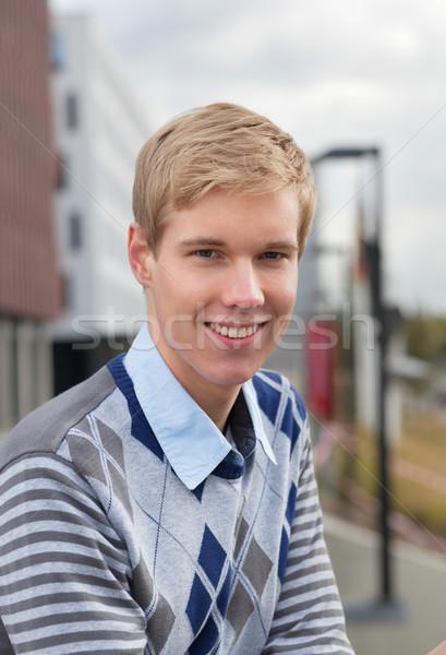 Mosolyog fiatalember szabadtér portré jóképű szőke Stock fotó © MikLav