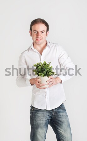 Young man with plant Stock photo © MikLav