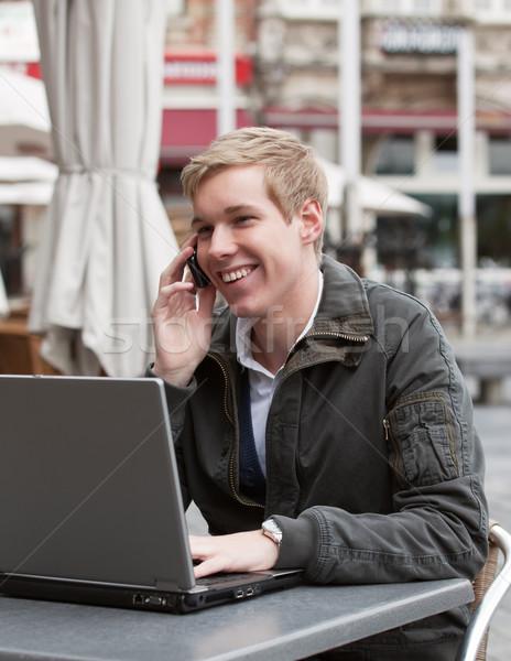 小さな 幸せ 男 電話 ノートパソコン 若い男 ストックフォト © MikLav