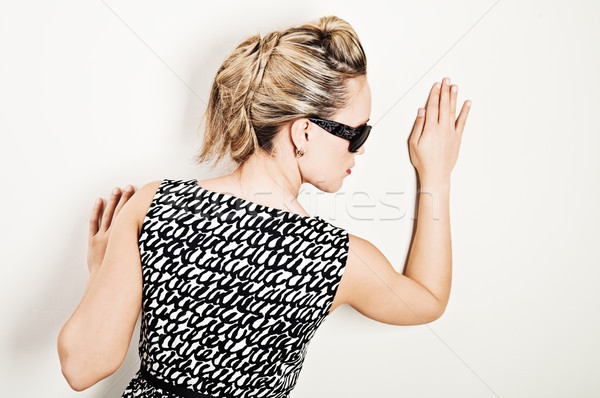 若い女性 サングラス かなり 触れる 壁 手のひら ストックフォト © MikLav