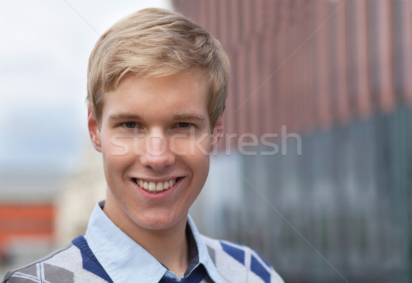 Smiling young man Stock photo © MikLav