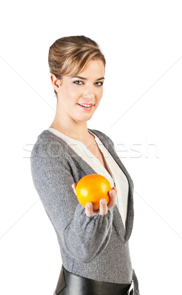 Pretty girl with an orange Stock photo © MikLav