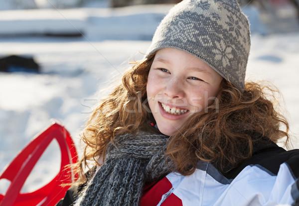 Mosolyog szőke lány tél park ül Stock fotó © MikLav
