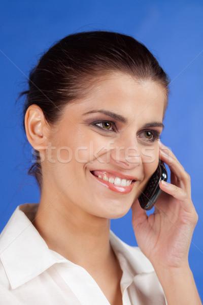 若い女性 携帯電話 笑みを浮かべて 小さな ブルネット 女性 ストックフォト © MikLav
