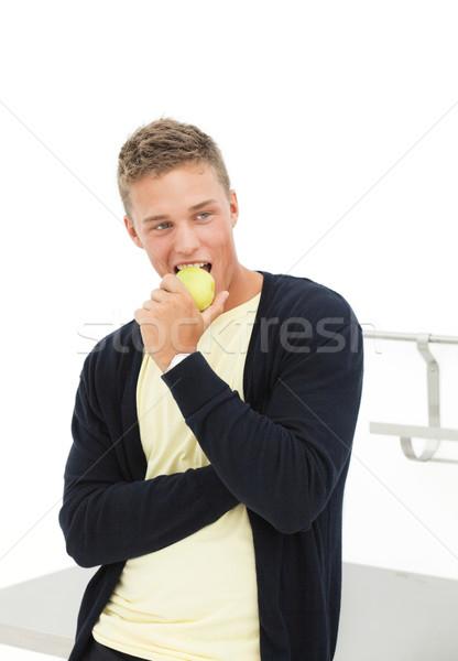 молодым человеком яблоко красивый человека еды Сток-фото © MikLav