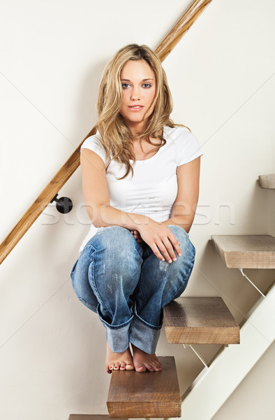 Young woman sitting on steps Stock photo © MikLav