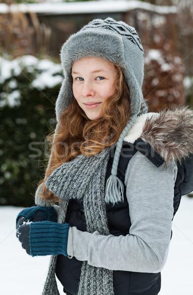 Teenager girl holding snowball Stock photo © MikLav