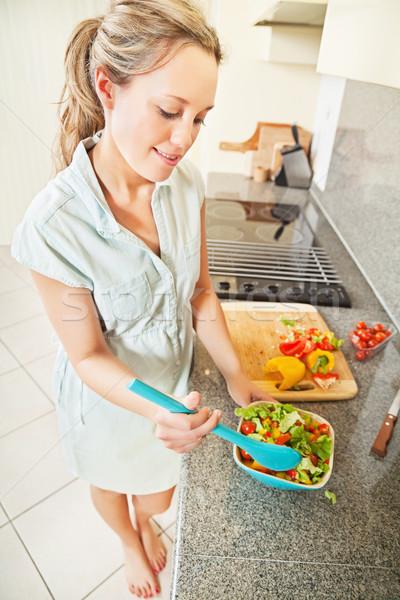 Young woman making salad Stock photo © MikLav