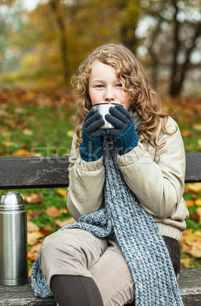 Girl in winter cloths drinking from flask cup Stock photo © MikLav