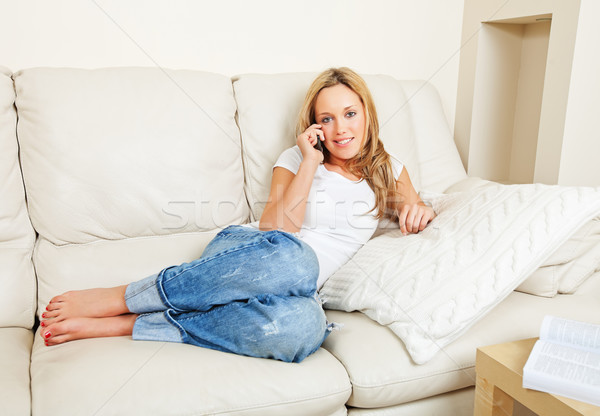 Fiatal nő kanapé telefon csinos otthon beszél Stock fotó © MikLav
