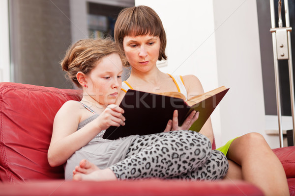Mother and daughter reading book together Stock photo © MikLav