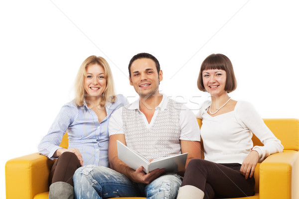 Smiling young people sitting together Stock photo © MikLav