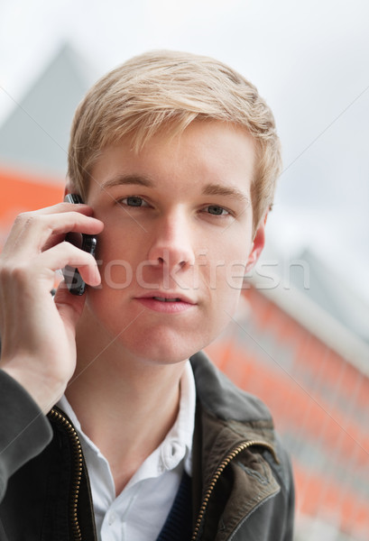 Handsome young man with cellphone Stock photo © MikLav