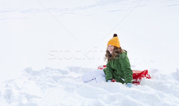 Girl with sleigh sitting in snow Stock photo © MikLav