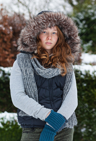 Girl in winter cloths and fur hood Stock photo © MikLav