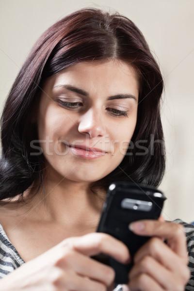女性 携帯電話 かなり 笑みを浮かべて ブルネット ストックフォト © MikLav