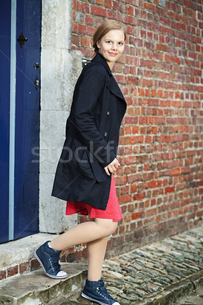 Young woman walks out of the door Stock photo © MikLav
