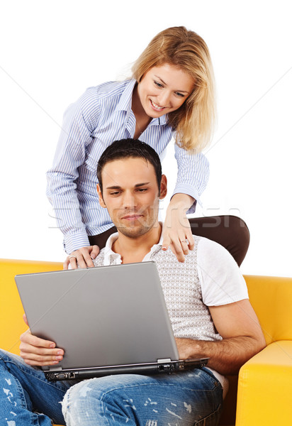 Happy couple on sofa with laptop computer Stock photo © MikLav