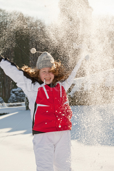 Stock photo: Teenager girl playing with snow in park