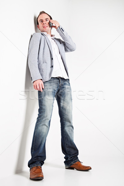 Young man with mobile phone Stock photo © MikLav