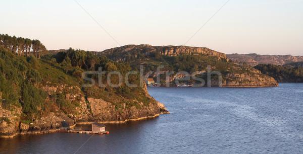 Rocky sea coast in sunset Stock photo © MikLav