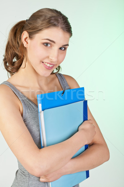 Stock photo: Girl with blue folders