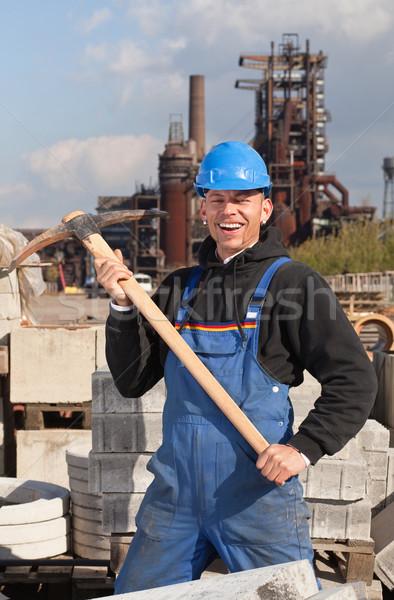 Feliz trabalhador sorridente azul em pé Foto stock © MikLav
