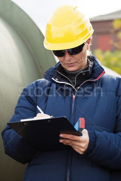 Construciton engineer taking notes Stock photo © MikLav