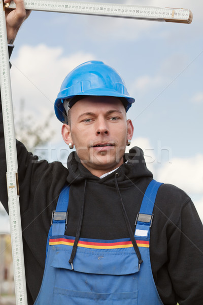 Worker with foldable ruler Stock photo © MikLav