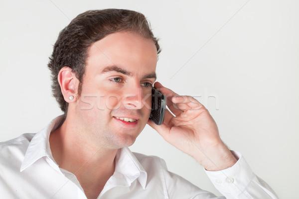 Fiatalember mobiltelefon portré beszél mobiltelefon mosoly Stock fotó © MikLav